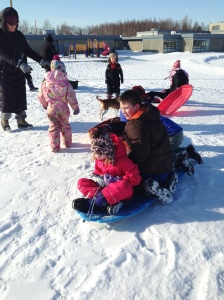 sledding at a nearby elementary school sledding hill